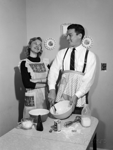 1950s-satisfied-amused-smiling-couple-husband-wife-in-kitchen-cooking-together