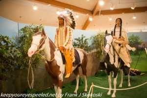 Native American couple on horse pack in traditional attire