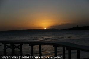 sunset over bridge and ocean