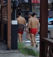 Gwangili Beach, Pusan, they were also sharing one pair of sandals