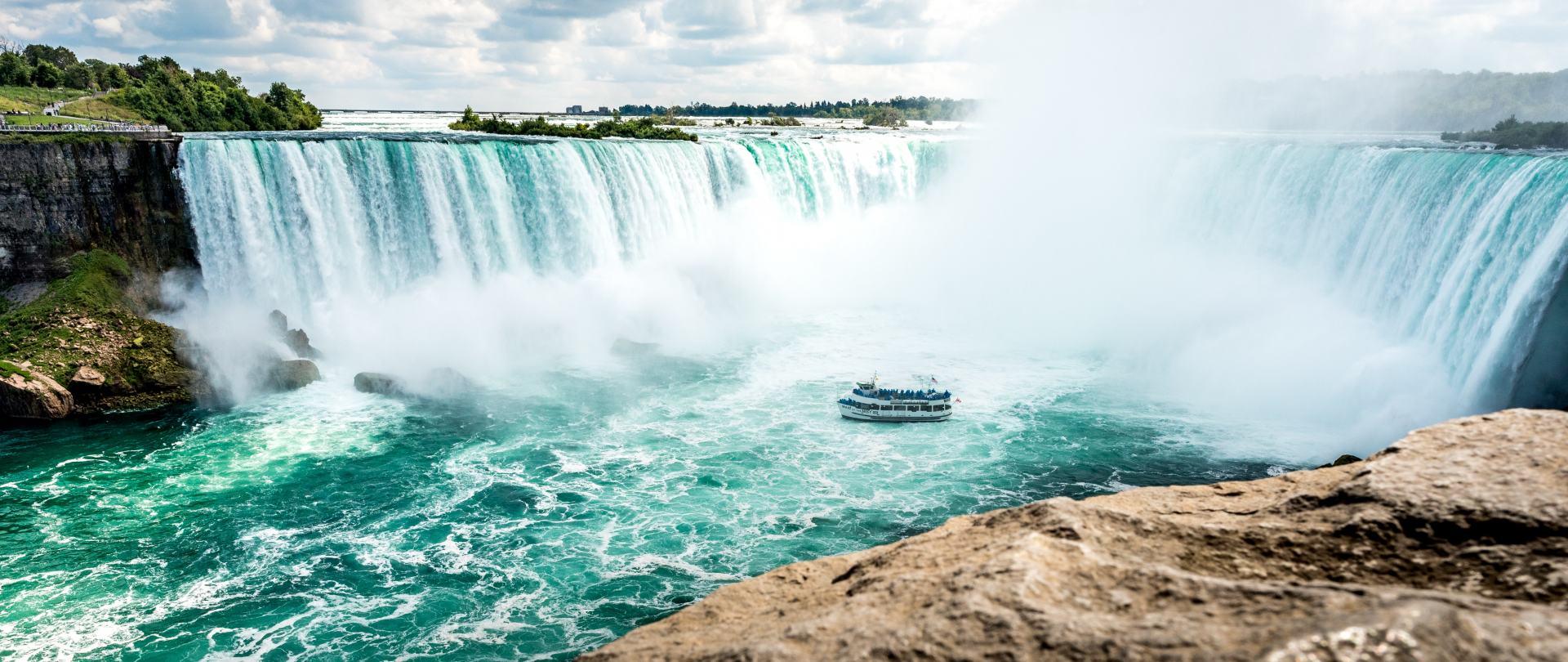 boat-beside-waterfalls-1374585.jpg