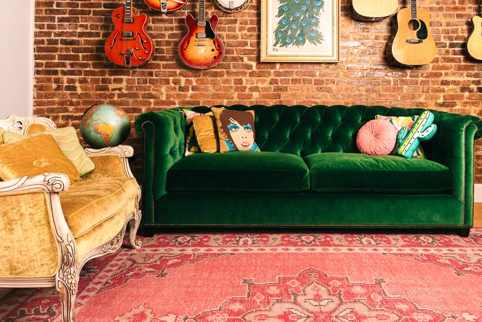 Lovely Green Velvet Tufted Sofa And Pink Rug