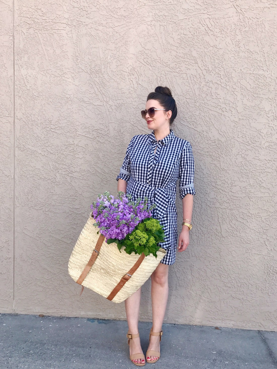 style blogger, casual spring summer outfit with black gingham wrap shirt dress and nude block heel sandals, fresh flowers in a basket bag