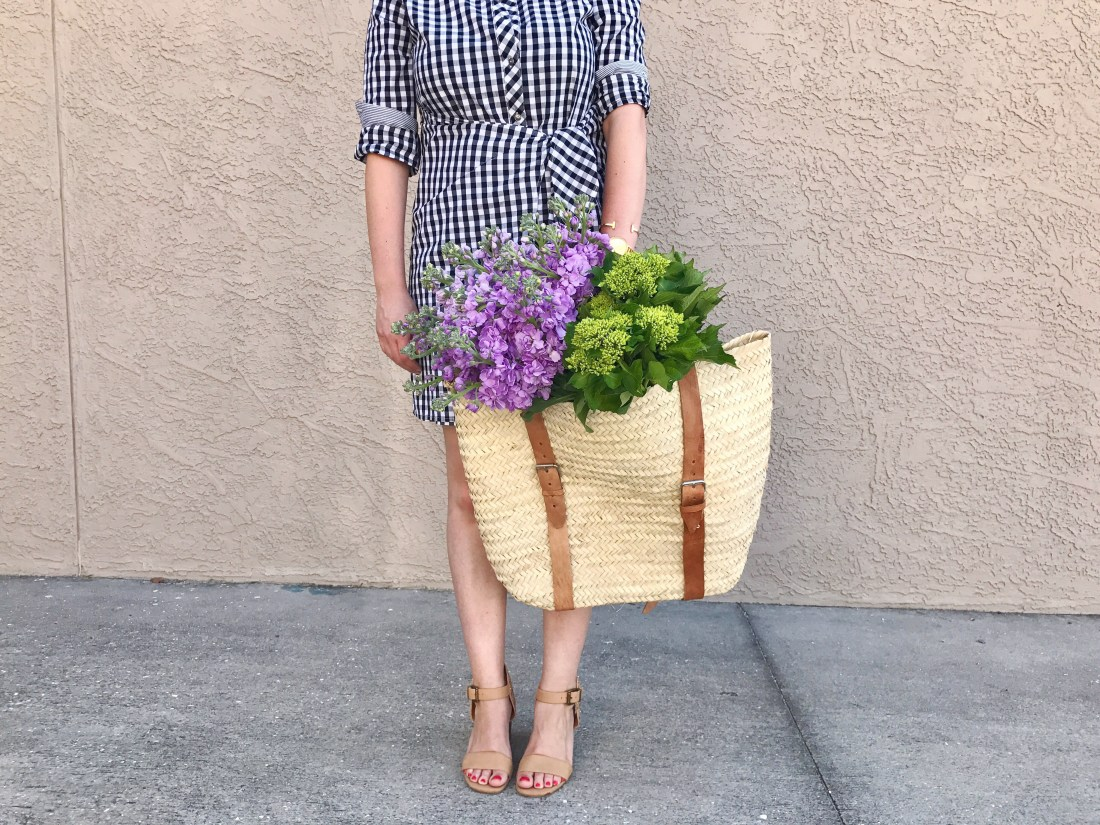 style blogger, summer style, black and white gingham shirt dress with nude block heel sandals and fresh flowers in a large woven basket backpack