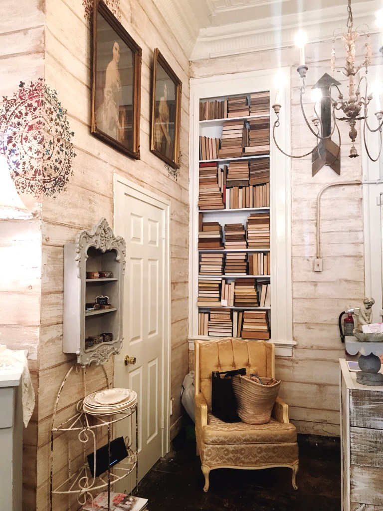 Book wall display in shabby chic boutique, The Fancy Flea Cottage Downtown Bartow FL