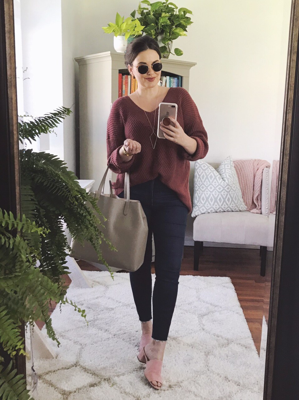 Style blogger wearing over-sized mauve sweater with Everlane Authentic Stretch Hi-Rise skinny jeans and blush pink suede mules and Ray-Ban hexagonal sunglasses, carrying Cuyana structured leather tote bag.