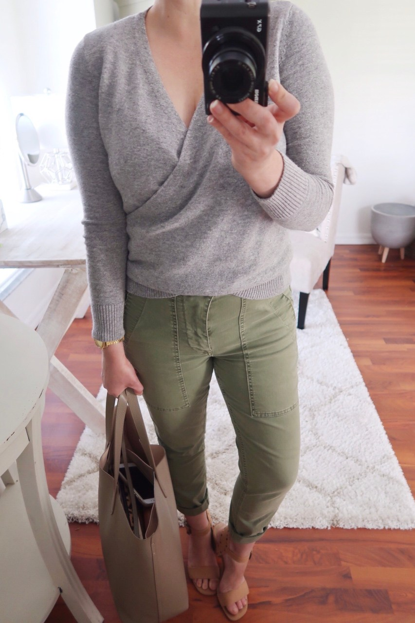 Style blogger wearing gray LOFT wrap sweather with olive J.Crew cargo chinos and tan leather sandals, holding a Cuyana structured leather tote.