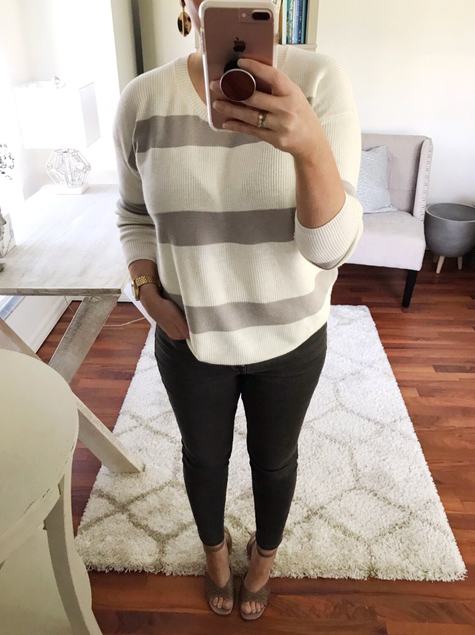 Style blogger wearing cream and gray striped sweater with Everlane authentic stretch hi-rise skinny jeans in washed black, accessorized with resin tortoise earrings and Italian leather espadrille sandals from TJ Maxx.
