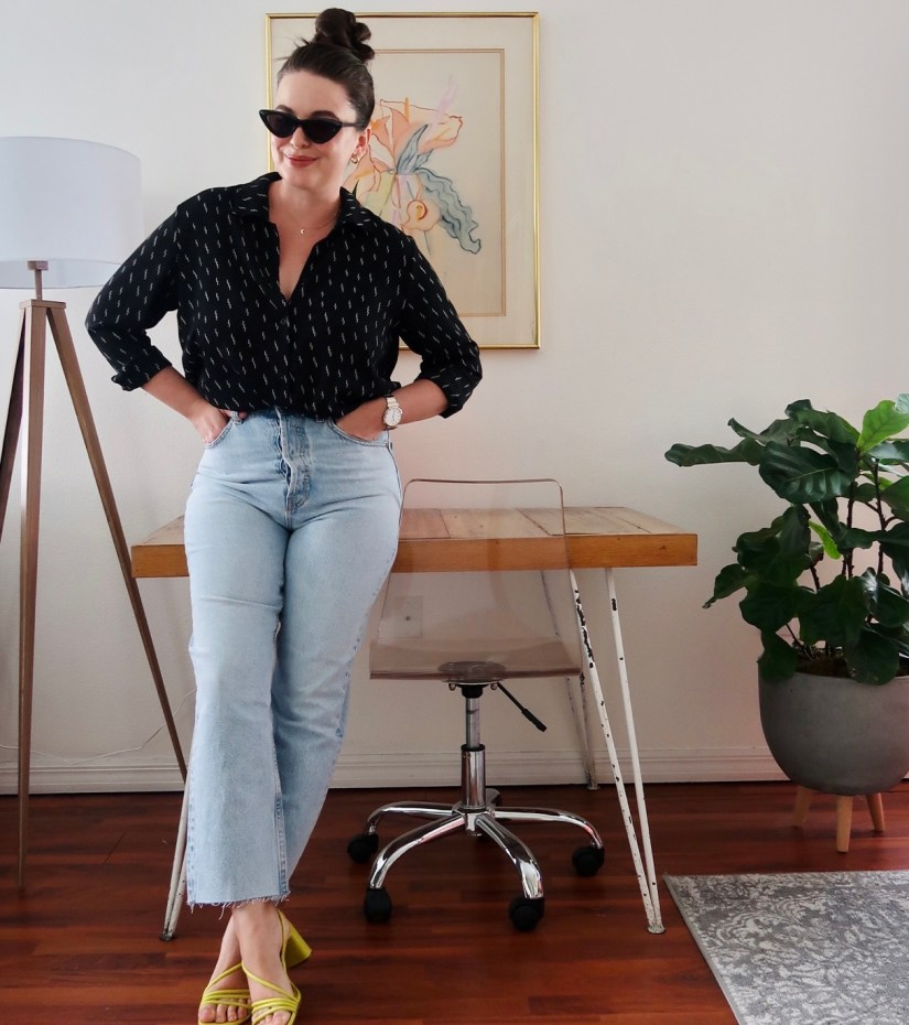 Style blogger wearing Zara straight leg jeans, black button down blouse and bright yellow summer sandals with Le Specs Lolita sunglasses