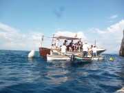 Transferring from motor boat to row boat to visit the Blue Grotto