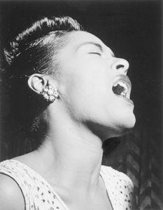Billie Holiday in Downbeat Magazine, Feb. 1947 [Public Domain]