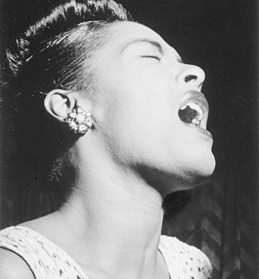 Billie Holiday in Downbeat Magazine, Feb. 1947 [Public Domain]