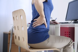 Woman with back pain at work