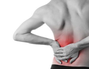 man holding his back in pain