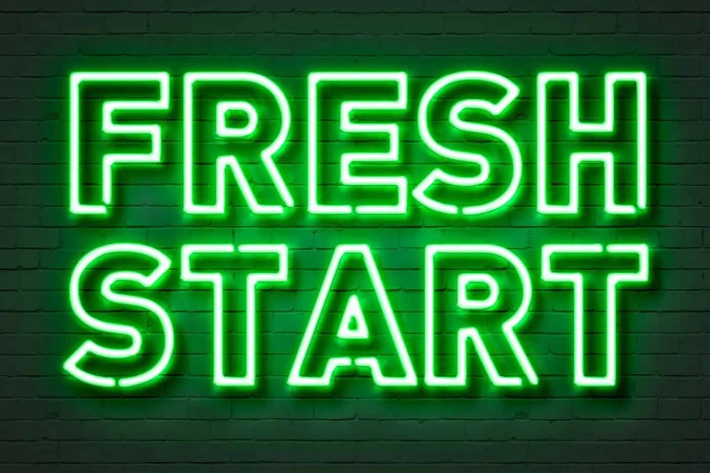 Fresh start neon sign on brick wall background