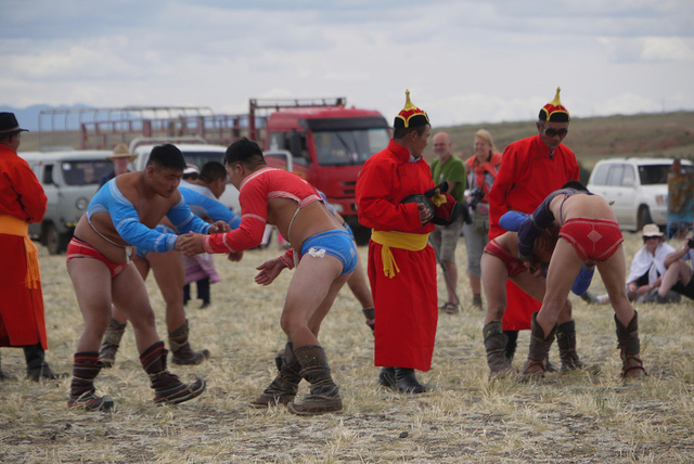 A picture of Mongolian wrestlers and their coaches.