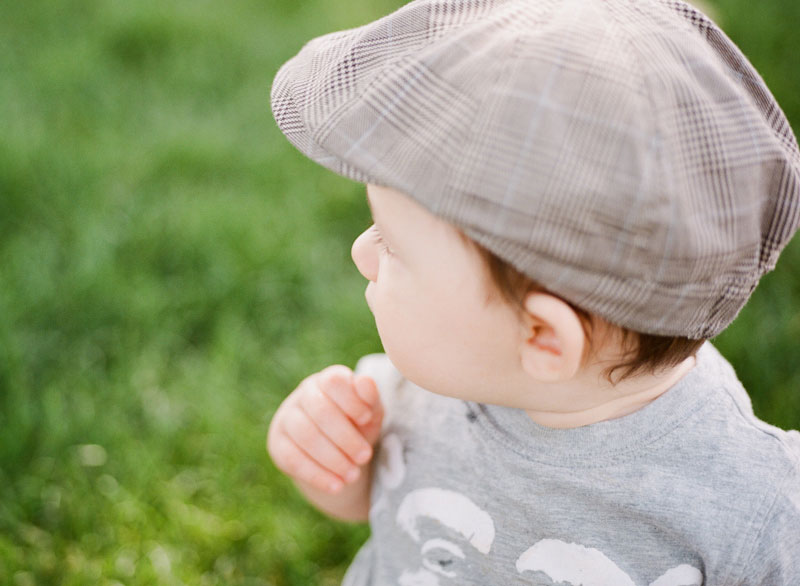 Baby in grass with cap by Dallas/Fort Worth film photographer