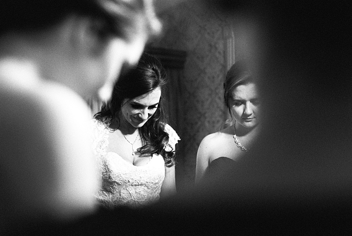 The bride saying a prayer with her mother and bridesmaids before the ceremony