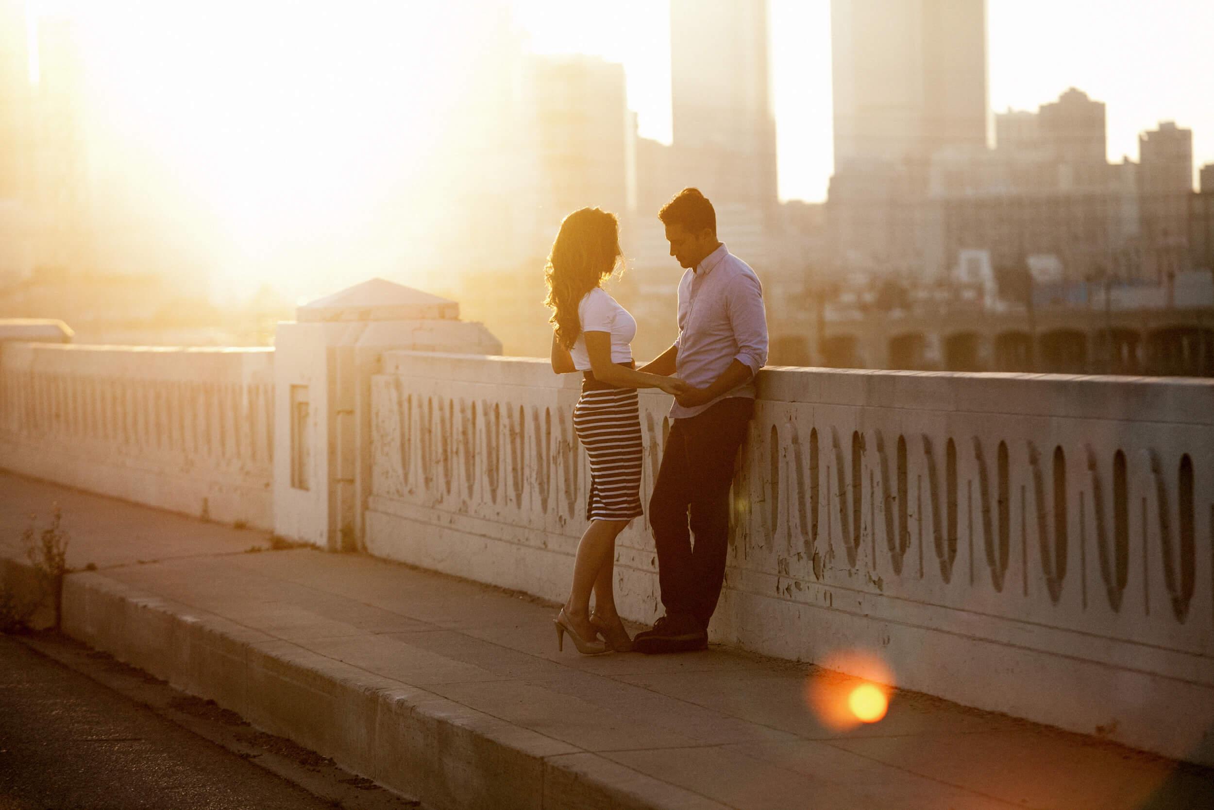 los angeles engagement photos couple on a bridge holding hands