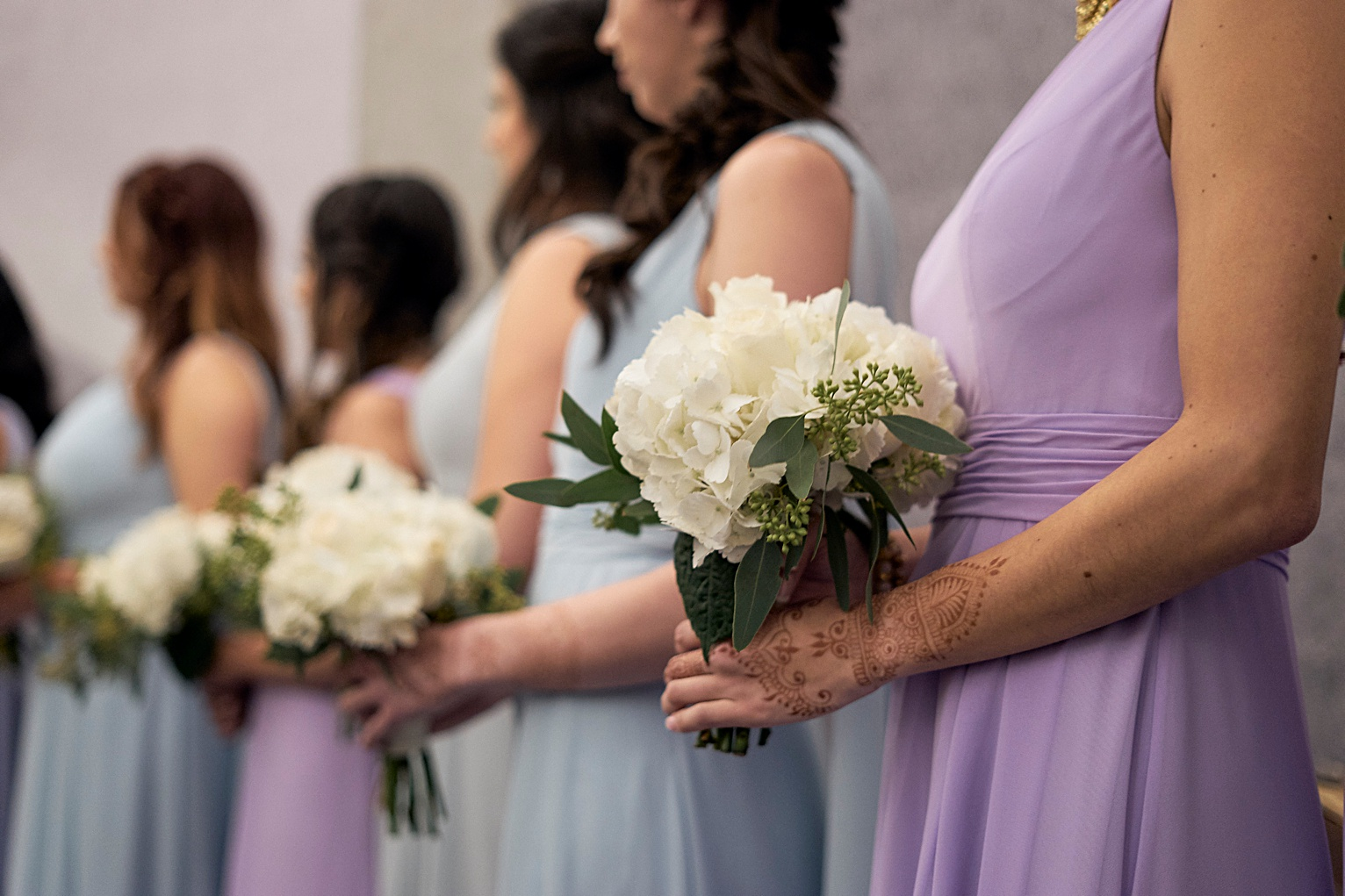bridesmaids during wedding ceremony holding bouquets