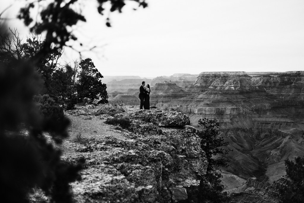 black and white photo of couple at the grand canyon