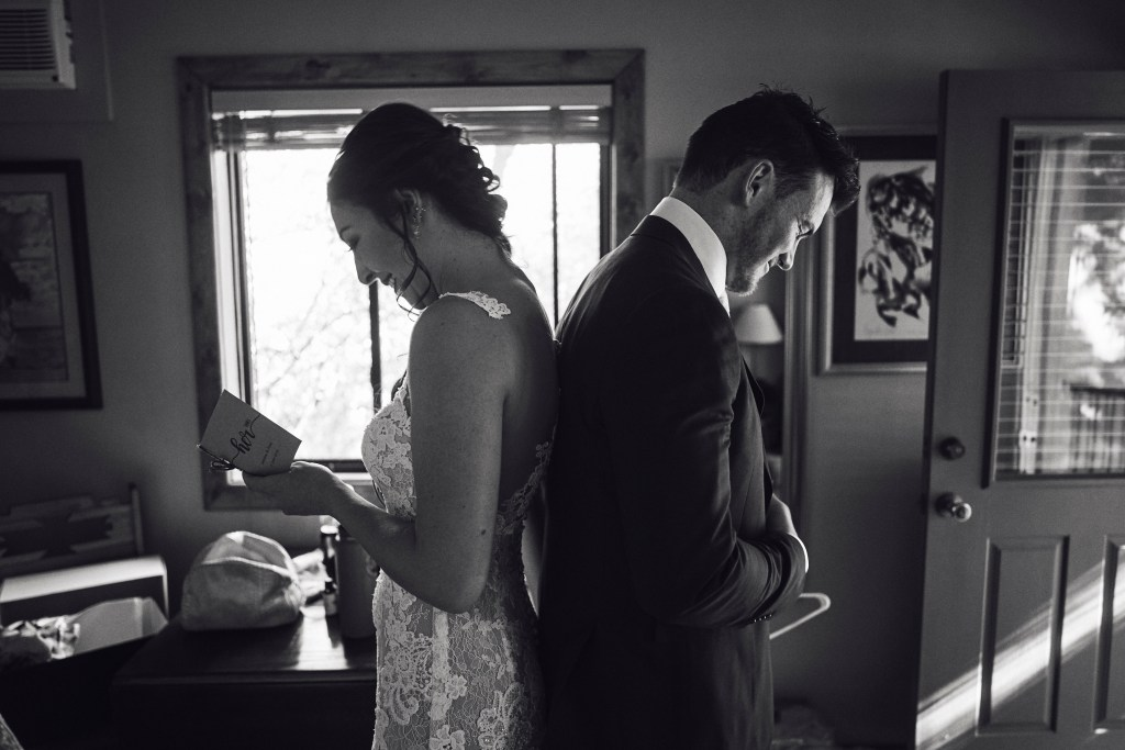 bride and groom reading a letter to one another
