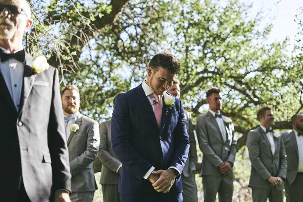 groom crying as bride walks down the aisle in prescott