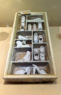 'Walk in My Shoes' by Daycare group of 10, HM Prison Pentonville, London, craft, in 'The Strength and Vulnerability Bunker' at Southbank Centre, Bankside, London. Photo credit Kelise Franclemont. The card reads, 'Before you criticize someone, walk a mile in their shoes'.