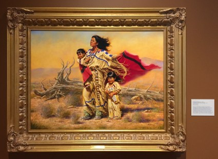 Alfredo Rodriguez, 'Wind beneath their wings', 2001, oil on canvas, at Booth Western Art Museum, Cartersville, GA. Photo credit Kelise Franclemont. The card reads: '...Rodriguez pays tribute to Native American women in this romanticised work. Such idealistic portrayals, however, are at odds with the hardship that often characterised the lives of the Plains Indians. Rodriguez, one of nine children, was born in Mexico near a Huichot Indian community.'