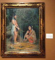 E. Irving Crouse, 'Incantation (making medicine)', 1918, oil on canvas, at Booth Western Art Museum, Cartersville, GA. Photo credit Kelise Franclemont. The card reads: 'A native of Michigan, EI Crouse was one of the most prominent founders of the Taos Society of Artists. Crouse is best known for his romanticised depictions of the Indians of Taos, New Mexico. In this mythical painting, he conveys the close connection between their spirituality and the natural world. However, the details of the ceremony, figures and background are an amalgamation of motifs, many of which come from other regions and cultures.'