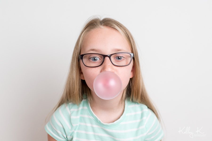 Girl-blowing-bubble-KelleyKPhotography-SmyrnaGA