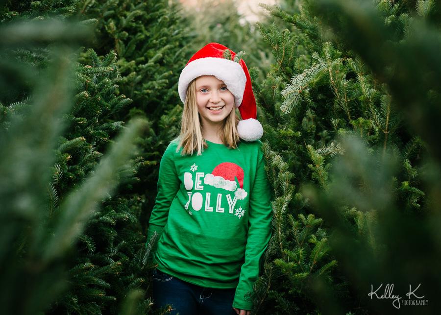 Girl-Christmas-tree-lot-jolly-KelleyKPhotography-SmyrnaGA