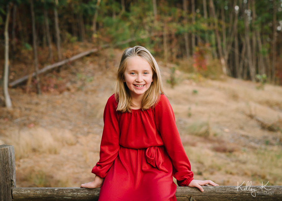 Girl-red-dress-fence-KelleyKPhotography-SmyrnaGA