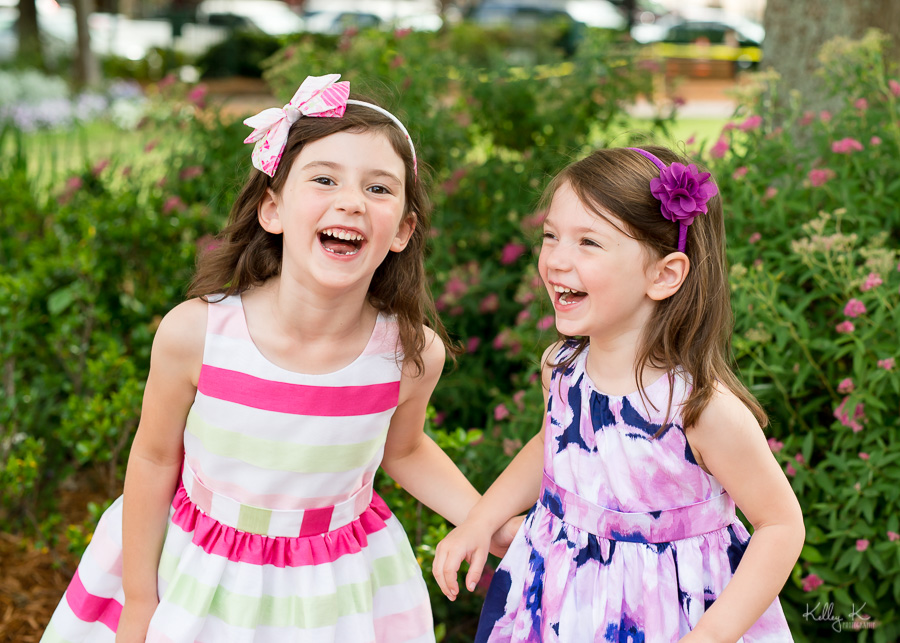Spring portrait of two sisters laughing