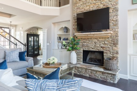 2018 Spring Home Tour  Decorating Ideas for Every Room in the House     Two Story Living Room with Versatile Gray Paint and TV OVer Stacked Stone  Fireplace
