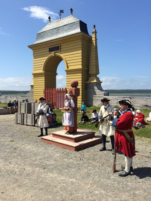 Re-enactors portray a trial in the community square.
