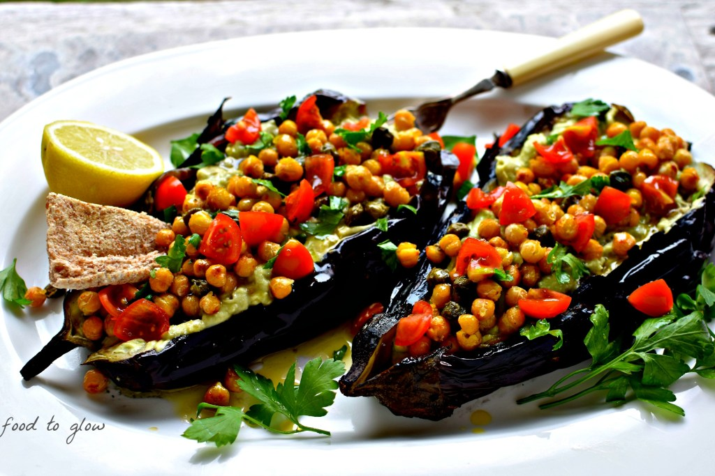 Meltingly soft fire-roasted eggplant plus creamy avocado sauce and salty, citrussy yuzu-spiked capers and chickpeas make this as much a meal as an impressive appetizer or dip.