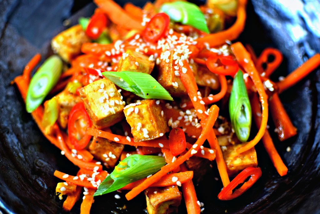 A quick and easy (and delish!) way to get your family to try tofu. Bake the tofu in the oven while you heat the throw-together sauce and sauté some carrots. Boom, it's dinner time! Gluten-free and naturally vegan.