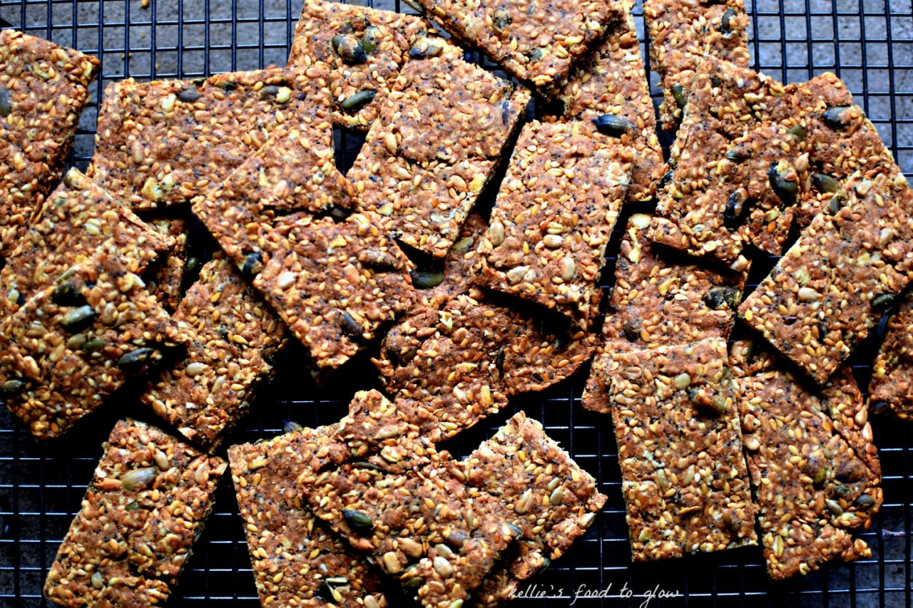 Scandinavian crispbreads made with minimal flour, some salt, oil, water and sesame, flax, poppy and sunflower seeds (and a few aromatic ones too) are a crunchy, delicate platform for butter, cheese, pickled herring and anything at all savoury. They are superb crunchy accompaniment to soup, too. Versions of knækbrød are eaten all over Denmark, Sweden and Norway and considered essential foods. High in protein, healthy fats and fiber, these are a near-perfect snack.