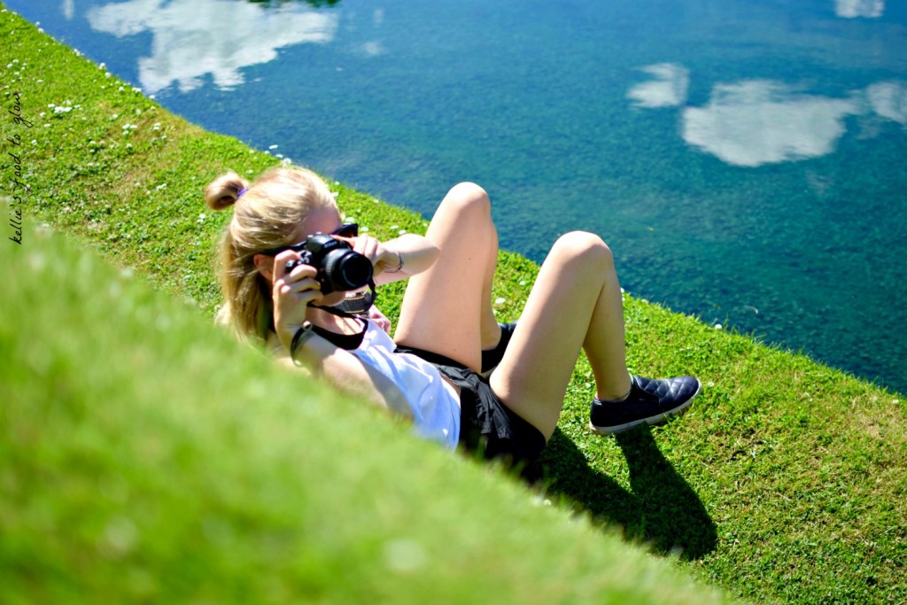 My daughter Rachel laying on the landform taking a pic of me taking a pic of her. I am one grassy tier above