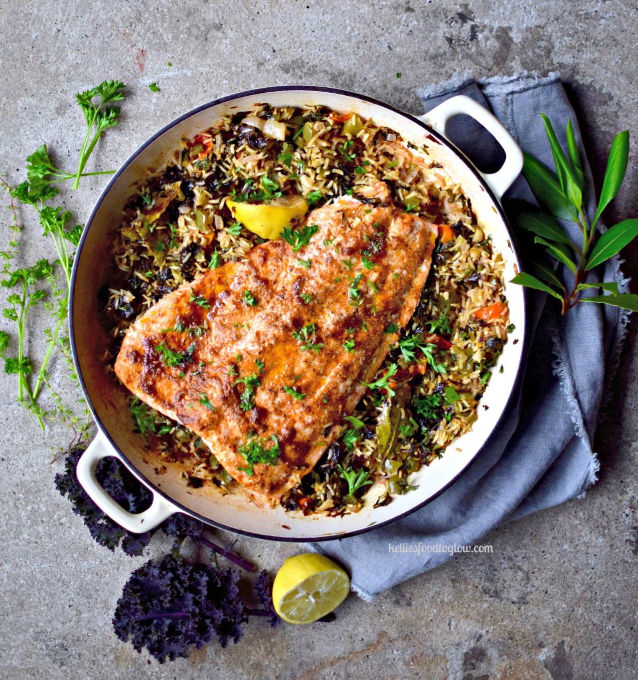 """Pearly-pink salmon kept juicywith a coating of creole spices and olive oil, cooked over vegetable-filled """"dirty"""" brown rice. Healthy, family-friendly and surprisingly quick and easy for a midweek dinner. Leftovers are great cold in a wrap - lettuce or grain."""