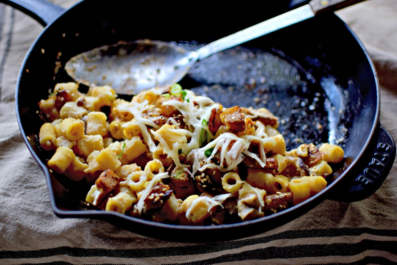 """Easy blender """"cheese"""" sauce with a savoury hit of white miso and shiitake mushrooms, topped with tiny sesame eggplant cubes, then mixed with cooked pasta and slammed under the grill. Oh, and it's vegan"""