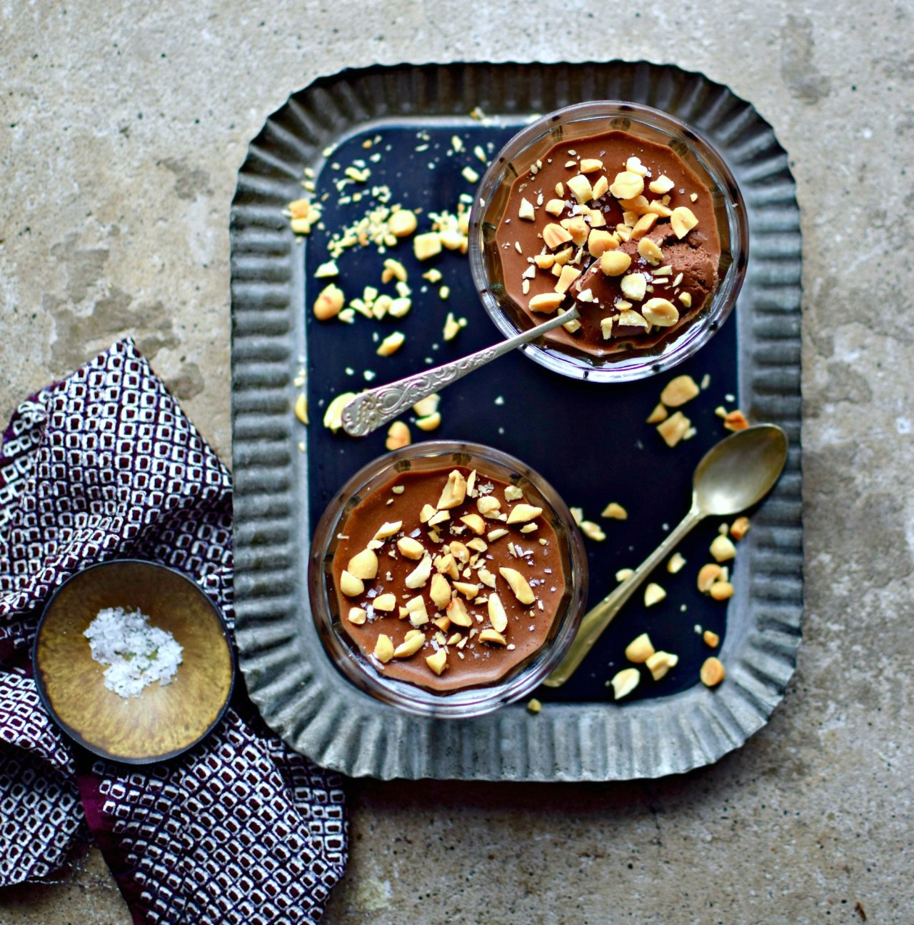 A slightly sweet, vegan chocolate mousse made with aquafaba and protein-packed peanut butter powder. Easy, light and perfect for a family or special occasion dessert. Top with crushed salted peanuts or pretzels for a flavour and texture contrast.