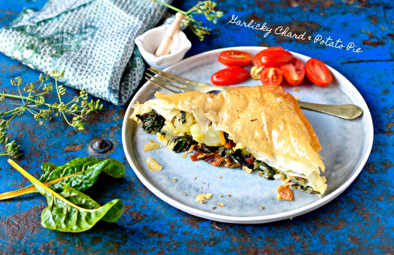 A Croatian-inspired savory phyllo pie filled with glowing-stemmed rainbow chard, skin-on potatoes, loads of garlic and toasted fennel seeds. Naturally vegan.