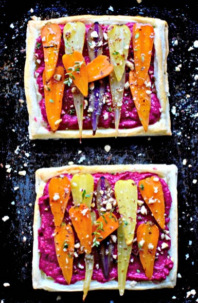 Forget the nut roast this Christmas and serve these vibrantly-coloured puff pastry tartlets. Topped with beetroot and goat's cheese puree and sweet roasted carrots, they are a perfect vegetarian showstopper main course. Especially as it can be made prepped ahead and assembled just before serving. You can also make this as one large tart.