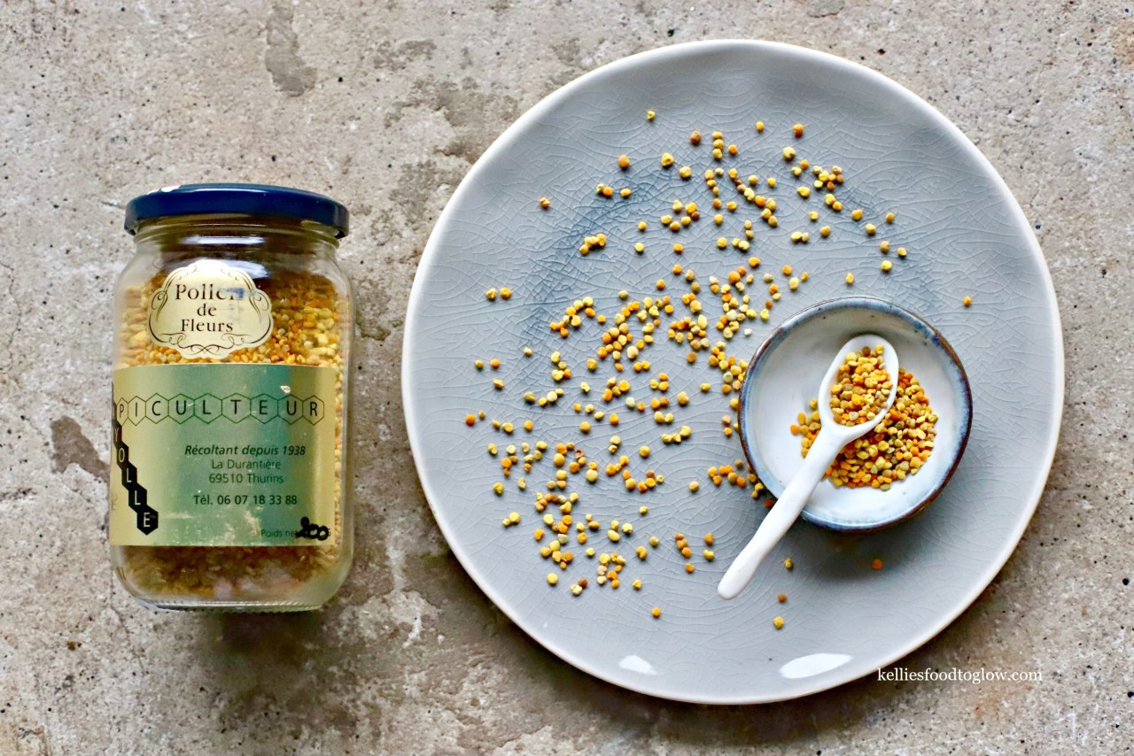 french bee pollen on crackle ceramic plate with handmade ceramic spoon by kelliesfoodtoglow.com