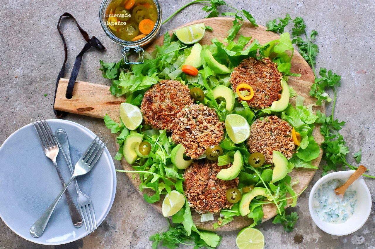 "Nicely spiced jackfruit ""crab cakes"" with jalapeño remoulade are delicious in a bun, on a salad, or on their own for lunch or dinner. And they are much easier to make than you might think. #vegan #jackfruit #crabcakes #easyrecipe"