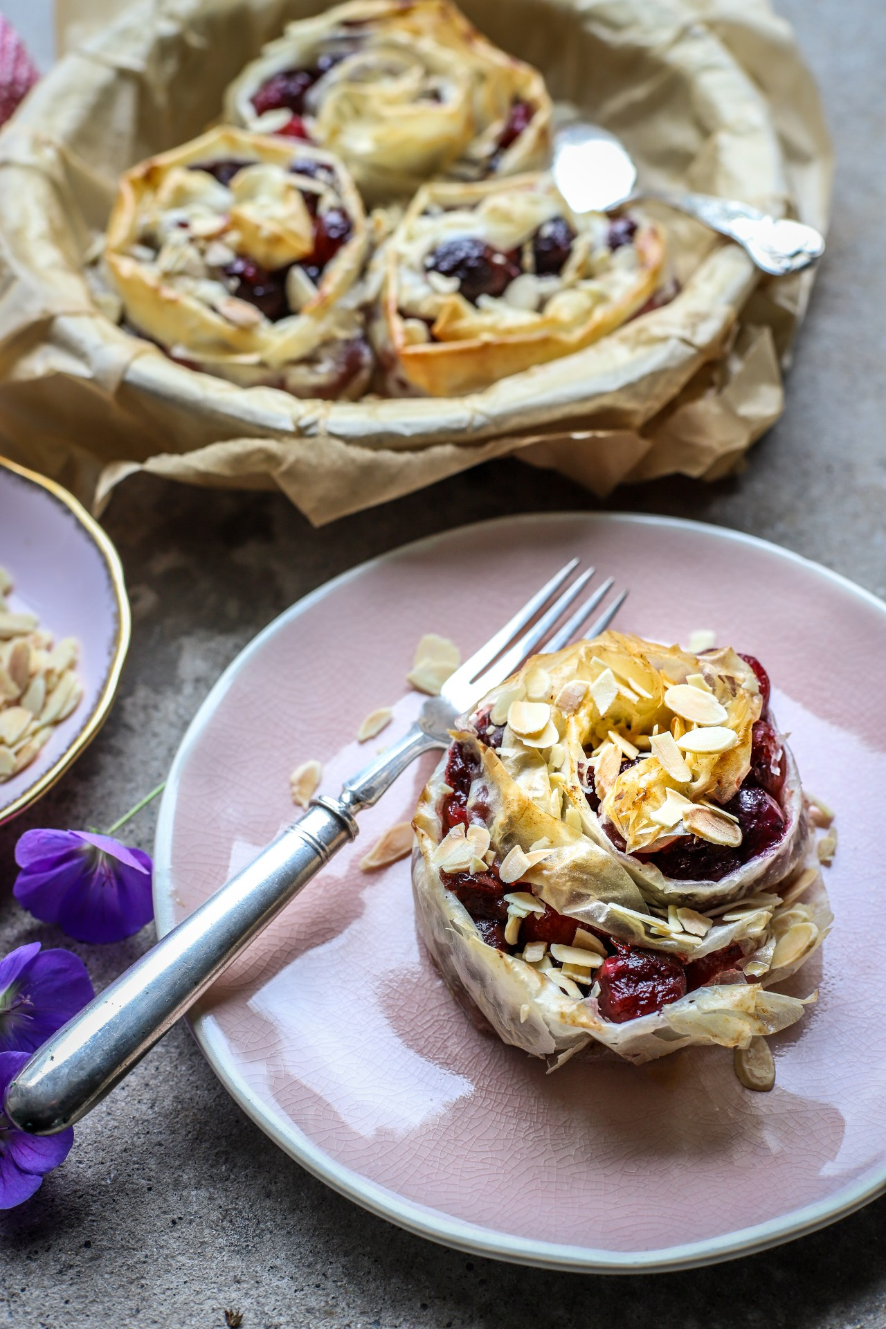 Easy Cherry and Cream Cheese Ruffle Hand Pies - make with a simple #cherry sauce nestled with (#vegan) cream cheese in rosettes of crunchy phyllo pastry. A healthy-ish sweet treat for #dessert.#pies #baking