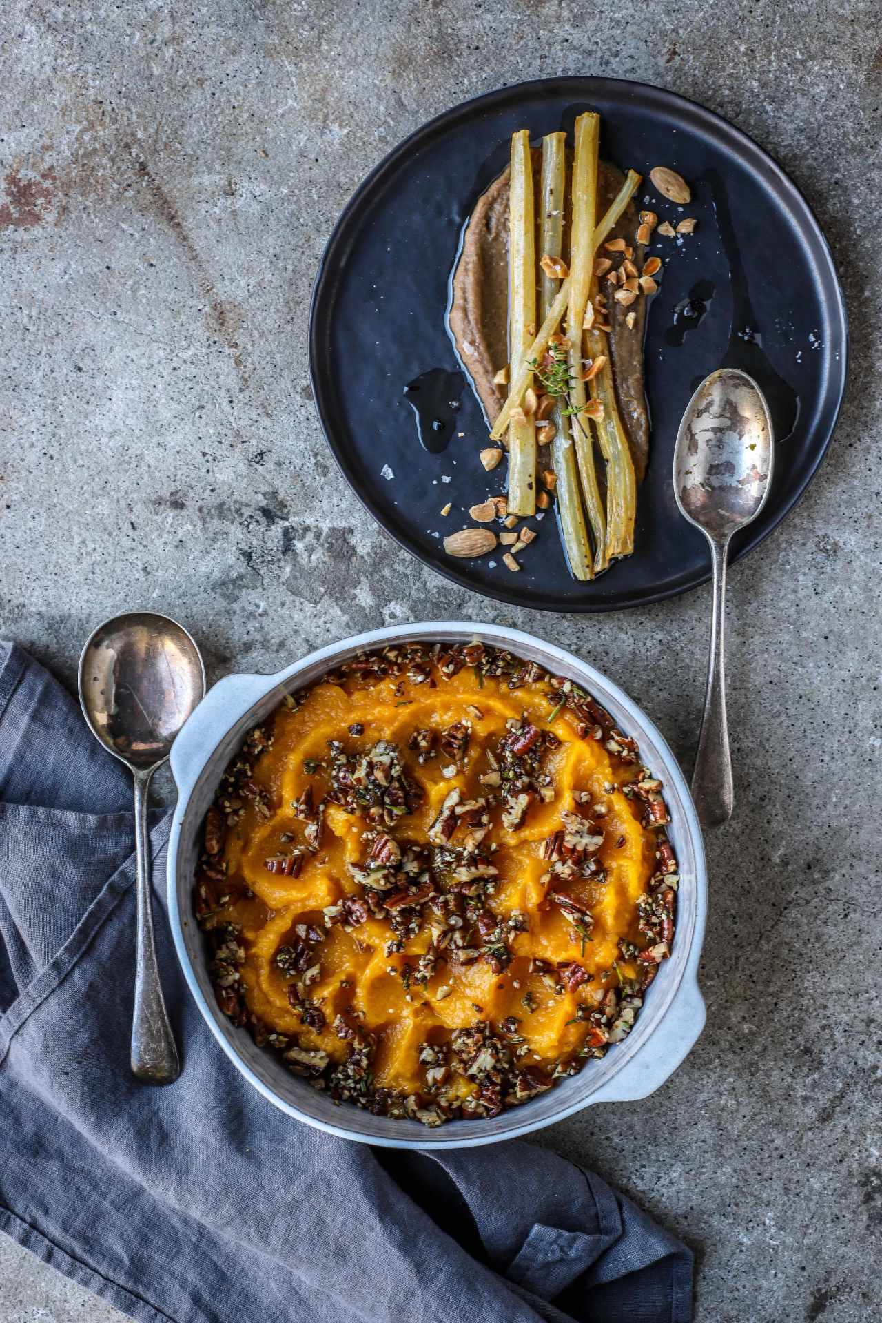 Swirls of roasted butternut squash mash topped with crunchy sweet-savory rosemary pecans. An easy and incredibly delicious side dish for holidays or any autumn-winter dinner. #vegetarian #sidedish #butternutsquash #Thanksgiving #Christmas #easyrecipe #makeahead
