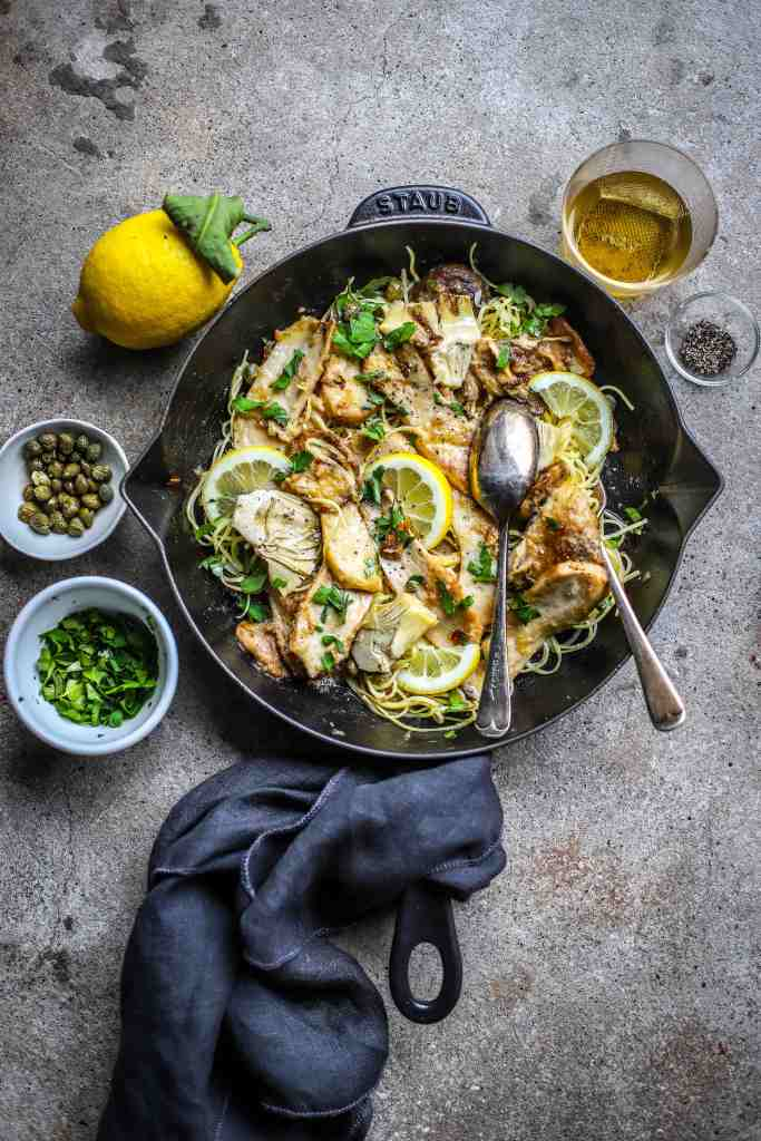 vegan mushroom piccata for dinner in cast iron skillet with artichokes